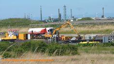 Aannemingsbedrijf Klein - Wieringen aan het werk in Den Helder met een van hun kraanschepen