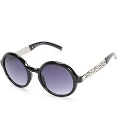 Add some stylish texture to any outfit with these round sunglasses that feature black glossy plastic frames accented with metal arms adorned with die-cut detailing.
