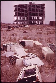 Old refrigerators and the shell of a high-rise at Breezy Point