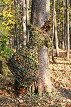 International Tree Day, Poland. The TreeHugger Project, by artists Agnieszka Gradzik and Wiktor Szostalo who have been building sculptures out of branches, leaves and vines for years.  more images available www.flickr.com/...