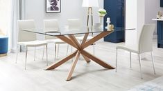 This walnut and glass dining table is truly a show-stopping piece, with a clear glass table top and walnut legs. This beautiful design is exclusive to Danetti. 8 Seater Dining Table, Walnut Dining Table, Glass Dining Table, Modern Dining Table, Dining Chairs, Latest Dining Table Designs, Modern Glass, Dining Room Design, Dining Furniture