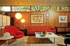 Architect Robert Metcalf's favorite space in the 1952 home he designed for him and his wife is the living room. Metcalf designed the white coffee table. The console and end table flanking the sofa are Nakashima