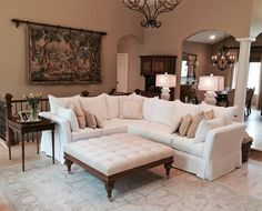 Quatrine Custom Furniture - Quatrine Custom Furniture - Beautiful home of our Chicago client. Featuring a Contemporary sectional slipcovered in a white linen, custom decorative pillows, a New Indies ottoman upholstered in velvet, and a pair of Victoria table lamps.