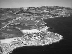 Ranch Palos Verde (1957)* - Aerial view of Marineland of the Pacific. View is looking slightly northeast. Palos Verdes Drive is visible from middle left to upper right; a few houses can be seen farther in the distance, and the Pacific Ocean flows on the right.