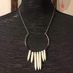 """Free People metal and ivory statement necklace This is a delicate piece with details that make a statement. The pendant features purple floss and ivory spikes. The chain measures 17"""" but can be adjusted to be a bit longer. Free People Jewelry Necklaces"""