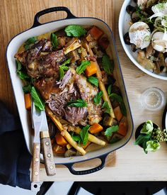 Grant Achatz's braised lamb shoulder with cocoa and cardamom - Preheat oven to 160C. Heat a large roasting pan over medium-high heat and season lamb shoulder generously.