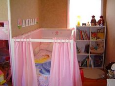 IKEA Kura bed in down position... with drapes! then turn it around and have the fort under when she's old enough.