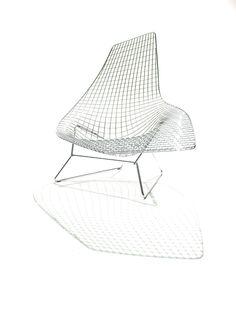 Bertoia Asymmetric Chaise / designed by Harry Bertoia