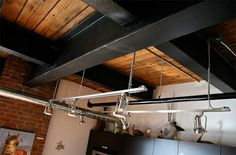 exposed steel beams, wood, brick