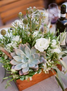 Succulents, scabiosa, lisianthus, eucalyptus, and rosemary would be great for a sturdy centerpiece for an outdoor summer wedding.