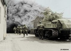 US infantry advance under the cover of a Sherman tank