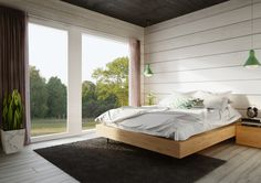 Big panorama windows in bedroom. Honka log homes.