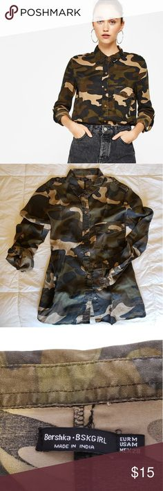 """Camouflage Button Down Blouse Army style camo military blouse. Buttons up and has one breast pocket. Bought in Portugal, it is a European medium.   Sleeves roll up and have inner buttons to secure them!  Fits the same as a US medium, loosely on myself. I am 5'2"""", 115lbs. Worn once. Bershka Tops Button Down Shirts"""