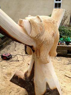 Chainsaw carved sleeping bear