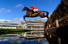 NOVEMBER 27: Stevn Clements riding Susquehanna River clear the water jump in The Burges Salmon Amateur Riders' Handicap Steeple Chase at Newbury racecourse on November 27, 2014 in Newbury, England. (Photo by Alan Crowhurst/Getty Images)