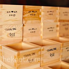 "To bring Sachi's Japanese heritage into the mix (and because Ken doesn't like champagne), the couple had a sake toast. They bought sake boxes for guests to use and take home, added their initials and wedding date, and stamped them with adorable ""thank you..."