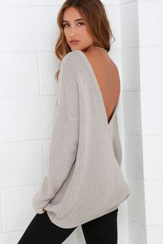 When your adventures include a light breeze, make sure the Island Ferry Taupe Sweater comes along for the ride! Medium-weight knit begins at a rounded neckline, then travels to a trendy, low V-back. Wide-cut bodice and loose long sleeves taper slightly to ribbed knit hems.