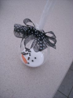 A Texas Snowman.  Made With Salt, Peppercorns, And I Rolled Up, Cone Shaped Orange Piece Of Paper.  Starting On Homemade Christmas Ornaments.  Here's Where I Got The Idea From: http://papercuts4u.blogspot.com/2011/12/post-christmas-christmas-post.html