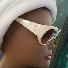 100% Authentic Baby Phat White Oval Sunglasses Brand Baby Phat  Style 2043BP Modified White Oval Sunglasses with Gold designer logo on Stem temple.  A+ Rim Construction Universal Bridge nose with Golden Brown Lens tint providing UV protection. Originally $49.95 verify price through website.  Bundles available with discounts Baby Phat Accessories Sunglasses
