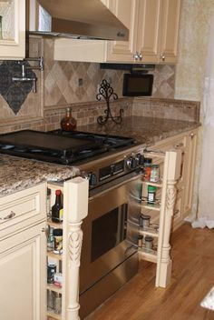 Mobile and Manufactured Home Living French Country Gourmet Kitchen Remodel.....as utterly awesome as these pull out spice shelves are, the heat from the stove/oven are not good for the longevity of spices. Which is also why you should never store spices on top of the oven ledge.