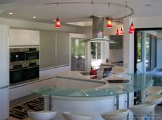 Best Kitchen Interior Design Ideas: White kitchen cabinet with semi round glass bar table Contemporary Kitchen Cabinets, White Kitchen Cabinets, Cupboards, Glass Bar Table, Images Of Kitchen Islands, Curved Kitchen Island, Curved Glass, Round Glass, Best Kitchen Designs