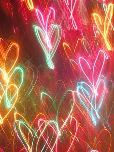 Neon heart lights. I could do this on my old phone's camera by moving while snapping the picture. So cool and fun.