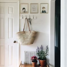 [cute entryway with flowers and pictures]