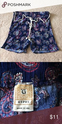 Blue Designed Shorts Size XL but can definitely fit someone who is a medium of large. Worn twice - great condition. Comes with rope belt. Stretchy. Shorts