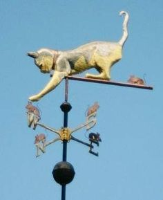 Cat playing with Mice Weathervane by West Coast Weather Vanes.  This  cat handcrafted custom made weathervane features glass eyes, brass whiskers, gold leafed calico patterns and a kitty collar with the cat's name on the collar.