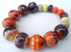 Lampwork.Glass bead handmade.Beads  purple,orange and gray . on Etsy, $40.00