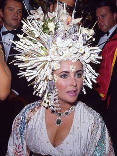 Forget her famous raven locks – Taylor covered it all up with a pearl-encrusted headdress for a ball in 1977.