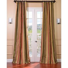 Add some dramatic flair to your window with this multicolor striped faux-silk taffeta curtain panel. Each panel features high-quality flannel interlining and cotton lining for insulation and three-inch pole pockets for easy installation.