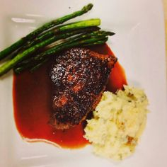 8-10 oz baseball sirloin with a demi glacé. Served with roasted asparagus and smashed potatoes