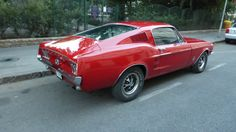 This is a ridiculously hot red 1968 Ford Mustang Fastback spotted in mint condition in Budapest. 1968 Ford Mustang Fastback, Budapest, Red, Photos, Pictures, Photographs, Cake Smash Pictures