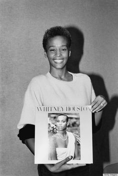 Whitney Houston with her first LP.