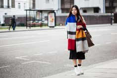 """15 Seriously Stylish Street Looks From London's Hottest Show #refinery29  http://www.refinery29.com/victoria-and-albert-museum-savage-beauty-exhibit-street-style#slide-13  Name: Gianna ChanJob: Jewellery designerWhat She's Wearing: Zara scarf and skirt, Topshop shirt, Prada bag, ASOS watch, and IT shoes.The Dover Street Market shopper's bold blanket scarf is a perfect example of her affinity for statement accessories. """"When you're wearing something plain, bring your stunning accessories out…"""