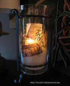 "Great idea: ""I printed some family pictures on cream-colored vellum and tucked them into the Galveston Hurricane with faux snow and sprigs of fresh rosemary. The photos are beautifully lit by the battery operated candle. Super simple - great centerpiece idea for reunions, retirement parties and golden anniversaries."""
