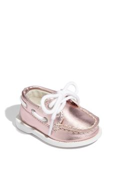Ridiculously cute and probably ridiculously impractical, but our baby must have a pair of these Sperrys.:)