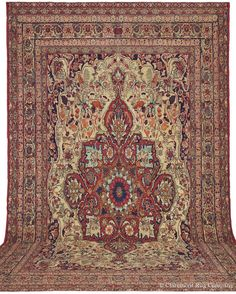 LAVER KIRMAN - Southeast Persian, 12ft 5in x 17ft 11in, Circa 1875. An intricately nuanced design brings tremendous refinement to this impressive oversize Laver Kirman.
