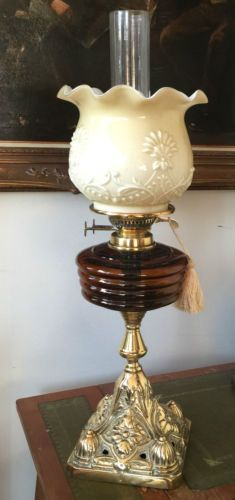 A-Victorian-solid-brass-oil-lamp-with-dark-amber-glass-reservoir-and-glass-shade