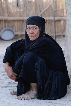 """Photographer Bruce Chadwick describes this photo he took of a woman in Iraq: """"She has survived through three wars, a ten year occupation, floods, famine and the loss of her ancestral home when the marshlands were drained by Saddam Hussein. The marshlands are slowly being re-flooded and with this, she told me hoped for the security and prosperity she remembered as a child."""""""