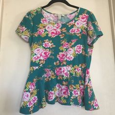 Peplum shirt Flowered peplum shirt. Good condition Forever 21 Tops Blouses