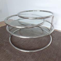I don't know if this is a Milo or not, but it sure seems like it could be. There are three tiers, the top two of which swivel all the way around and do separate from table for easier transport. The top three tiers have glass inserts. Milo Baughman, Cool Rugs, Hollywood Regency, Mid Century Design, Coffee Tables, Living Room Designs, Chrome, Separate, Glass