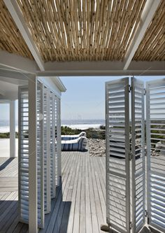 I like the idea of shutters on a track which can be open and closed. It can provide not only shade, but privacy.