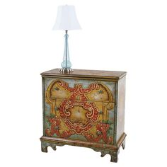 Awash in striking hand-painted details, this 3-drawer wood chest offers bold style for your hall or master suite decor.   Product: ...