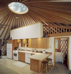 This is a nice yurt layout. Nice kitchen design and it also gives a private bedroom space, although I might make that the bathroom instead.