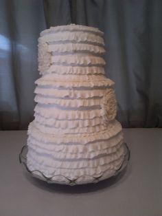 3 tiered ruffeled, butter cream cake