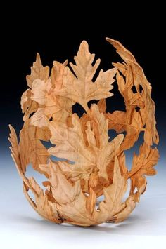 Enamored with this beautiful wood carving!  It reminds me of the autumn woods at the Four Seasons Trails in Madawaska, covered in crisp leaves that swirl with the wind.  |  Andi Wolfe, wood carving