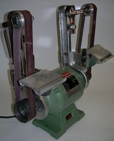 Twin Belt Sander - Homemade twin belt sander constructed from an electric motor, homemade aluminum castings, bar stock, springs, and contact wheels.