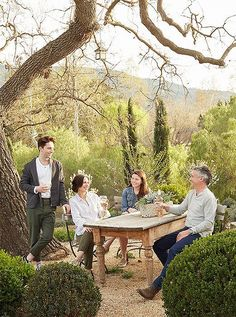 Brooke and Steve relax with two of their children in the alfresco dining area at Patina Farm in Ojai, CA.